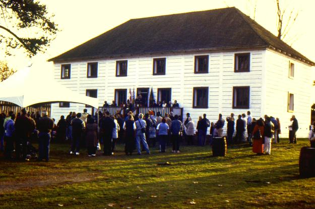 crowd attending event outside Fort Langley Big House